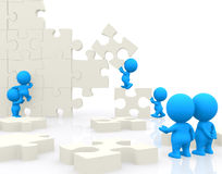 3D people making a puzzle Royalty Free Stock Photos