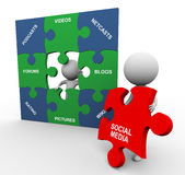 3d people with social media puzzle. 3d men completing social media puzzle Stock Photography