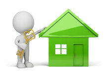 3d person - house and a golden key. 3d person standing next to the house with a golden key in hand. 3d image. White background Royalty Free Stock Photos