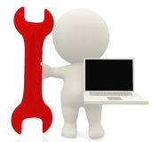 3D person with a spanner and a laptop Royalty Free Stock Image