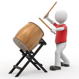 3d personage and drum. Royalty Free Stock Photography