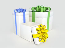 3d present boxes with colorful bows. Three gift boxes on a white background with colorful ribbons Royalty Free Stock Photography