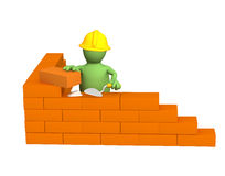 3d puppet - builder, building a brick wall. Object over white Stock Images