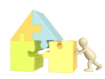 3d puppet, building the house. Over white Royalty Free Stock Photos