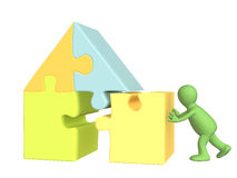 3d puppet, building the house. Over white Stock Photos