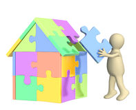 3d puppet, building the house Stock Photo