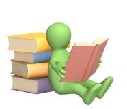 3d puppet, reading the book Stock Photo