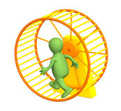 3d puppet, running inside a wheel Stock Photography