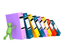 3d puppet, supporting falling folders. Object over white Stock Image