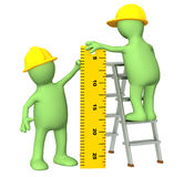 3d puppets - builders with ruler. 3d builders with ruler - over white Royalty Free Stock Photos