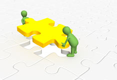 3d puppets installing yellow part puzzle. 3d people - puppets, installing yellow part puzzle Royalty Free Stock Photo