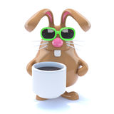 3d Rabbit drinks coffee Royalty Free Stock Photography
