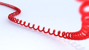 3D red phone cord Stock Image