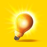 A 3D rendered lightbulb. Bulb isolated with yellow background Royalty Free Stock Image