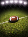 3d Rendering Of A Football On A Field With Stadium Lighting Stock Photos