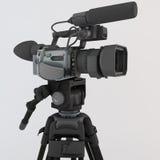 3D rinden de una cámara de vídeo en el trípode Imagen de archivo libre de regalías