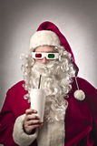 3D Santa Claus. Santa Claus wearing tridimensional glasses and drinking a soda Stock Images