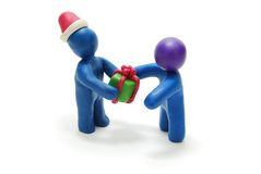 3D Santa Giving Gift to Person Stock Image