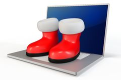 3d santa's boots and laptop Stock Photo