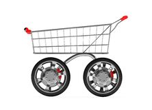 3d shopping cart with car wheel isolated Royalty Free Stock Images