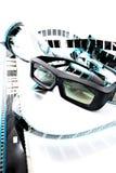 3D shutter glasses. On film strip Royalty Free Stock Images