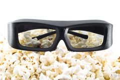 3D shutter glasses on popcorn. Ready to watch movie in three dimensions Stock Photography