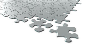 3D silver puzzle. Conceptual 3D art showing the Jigsaw puzzle piece coming into place on white background Stock Photos