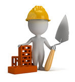 3d small people - builder in the helmet. 3d small person - builder in the helmet with a shovel and bricks. 3d image. White background Stock Photography