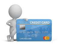 3d small people with a credit card. 3d small person standing next to a credit card. 3d image. White background Stock Image