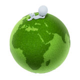 3d small people - Green Earth. 3d small people lying on a green planet. 3d image. Isolated white background Royalty Free Stock Photos