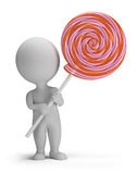 3d small people - lollipop. 3d small person holding a big lollipop. 3d image. White background Royalty Free Stock Photography
