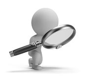 3d small people - searching. 3d small person with a big magnifying glass. 3d image. White background Royalty Free Stock Photo