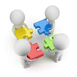 3d Small People - Team With The Puzzles Royalty Free Stock Image