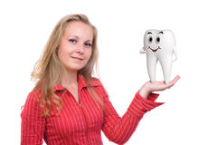 3d smiling Tooth on womans hand isolated Stock Photography