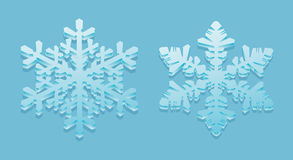 3D-snowflakes. On a blue background Royalty Free Stock Images