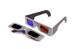 3D Specs. Cheap cardboard 3D spectacles with blue and amber lenses isolated against white background Stock Image