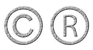 3D Stone Copyright and Registered Symbols. Isolated in white Royalty Free Stock Images