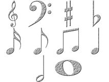 3D Stone Music Notes. Isolated in white Royalty Free Stock Image