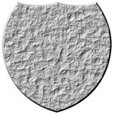 3D Stone Shield. Isolated in white Royalty Free Stock Photo