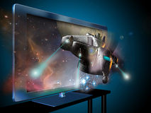 3D television. A 3D led television with an image of  a spaceship   coming out of the screen Stock Photography