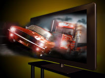 3D television. A 3D led television with an image of  a pursuit between a car and a truck coming out of the screen Stock Photos