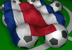 3D-teruggevend de vlag en de voetbal-ballen van Costa Rica Royalty-vrije Stock Foto's