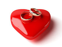3d trouwringen en hart Stock Fotografie