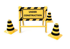 3D Under construction barricade. 3D Under construction warning sign with white background Royalty Free Stock Photos