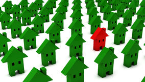 3d viele grünen Häuser man ist rot Stockfoto
