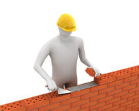 3D white builder lays bricks. Isolated on white background Stock Image