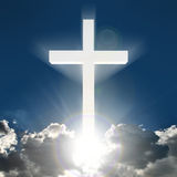3D white cross in sky. 3d floating bright white cross with beaming light above clouds Stock Photos
