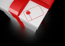 3d white gift box. With blank card on black background Royalty Free Stock Images