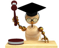 3d wood man holding a gavel Royalty Free Stock Photography