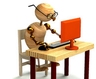 3d wood man working at computer. Isolated Royalty Free Stock Photo